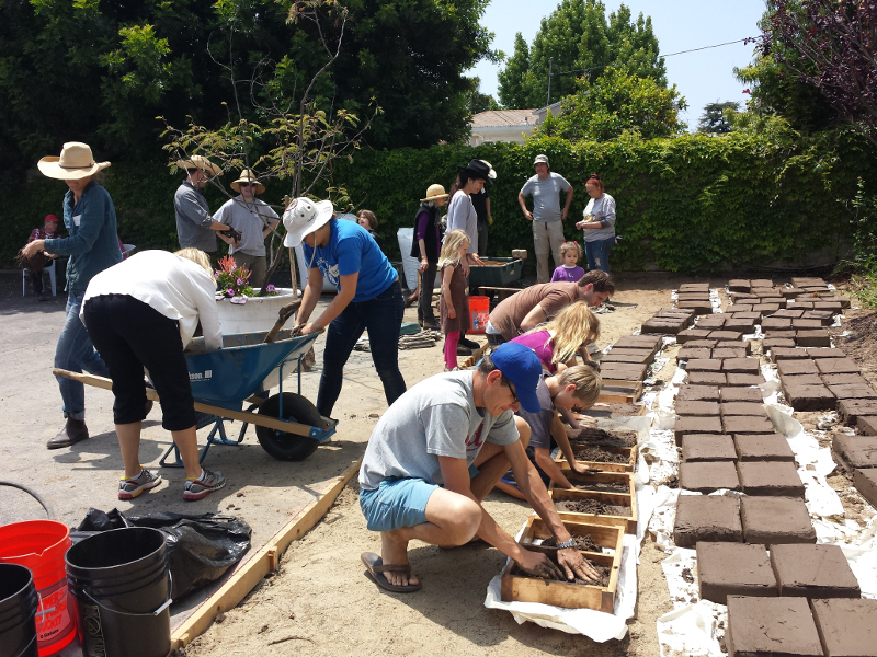 mixing is serious stuff adobe brick making at the community garden at holy nativity may 2015 - Brick Garden 2015